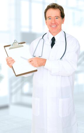 senior happy caucasian doctor point to his empty blank clipboard photo