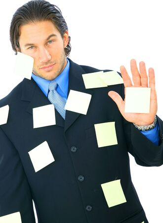 young businessman with upset expression have many post it notes on his body photo
