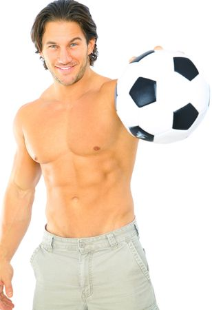 attractive sporty young male holding soccer ball on his hand Stock Photo