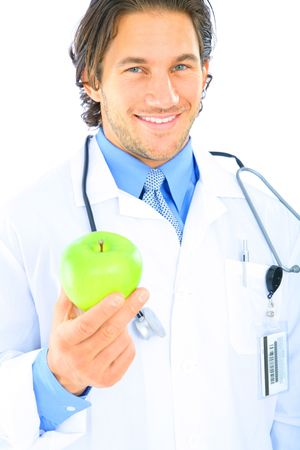 happy caucasian doctor holding green apple to viewer. concept for healthy eating photo