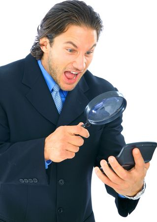 shocked and stressed accountant looking at calculator with loupe Stock Photo