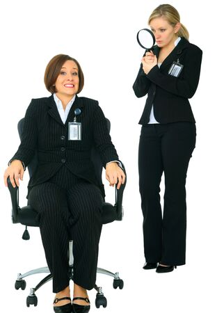 scared caucasian businesswoman under watch by other business investigator Stock Photo - 4080357