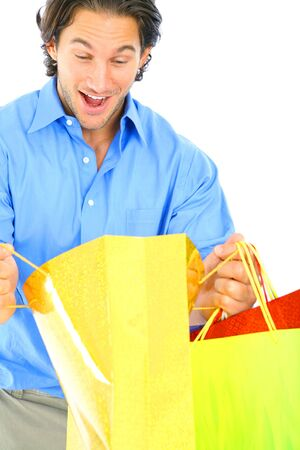 happy young caucasian male looking inside shopping bags photo