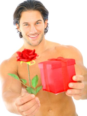 young man topless offering red rose and red box gift to viewer Stock Photo