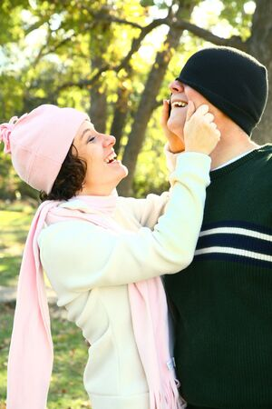 young adult embracing while walking in the park Stock Photo - 4124023