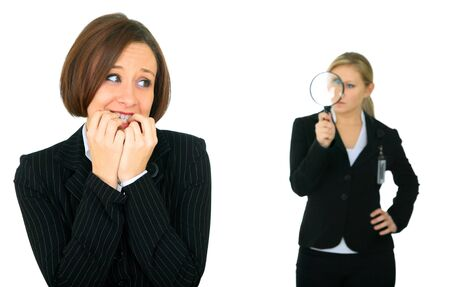 scared caucasian businesswoman under watch by other business investigator Stock Photo - 4208405