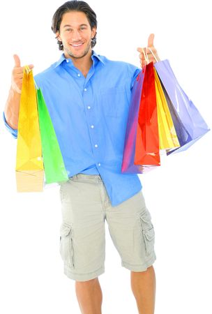isolated young caucasian man carrying shopping bags Archivio Fotografico