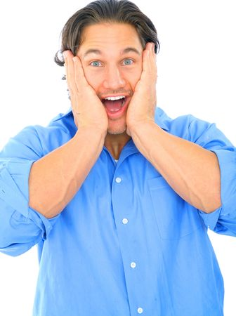 shocked young male holding his cheek looking to viewer Stock Photo