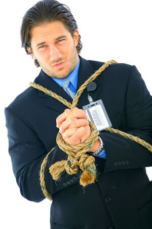 businessman tied up with rope showing angry expression. concept for bankruptcy, credit crisis, or debt photo