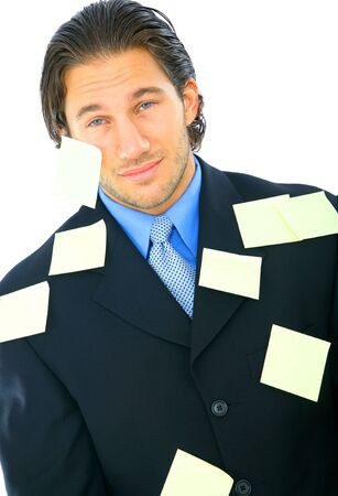 young businessman with tired expression have many post it notes on his body photo
