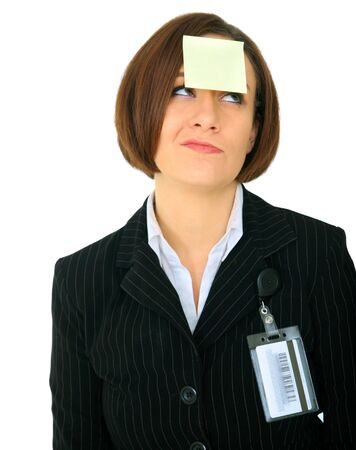 unhappy businesswoman has blank empty post it note on her forehead photo