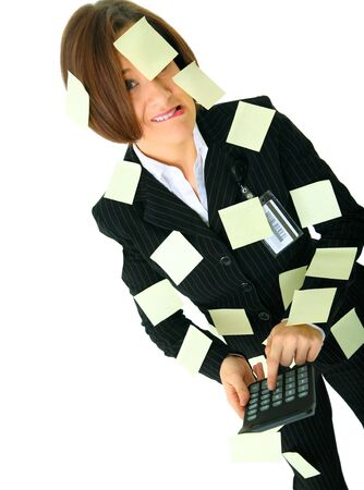 stressed female accountant holding calculator has many empty post it note on her suit photo
