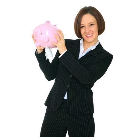shaking out: excited female caucasian shaking her piggy bank with a lot of money come out Stock Photo