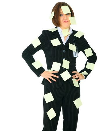 unhappy female businesswoman has many empty post it note on her suit photo