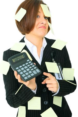 stressed female accountant showing calculator has many empty post it note on her suit photo