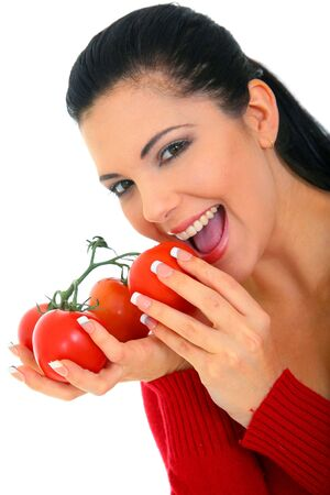 young woman smiling eating fresh tomatoes. shallow depth of field Stock Photo - 6299619