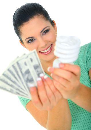 Guardar el concepto de energía. joven sosteniendo la bombilla y dinero Foto de archivo - 6299614