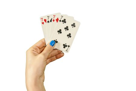 jack pot: A hand holding 4 Lucky seven over white