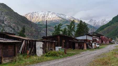 Snowy mountain peak behind the old village. Banque d'images