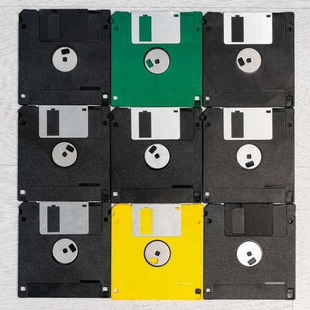 Old floppy disks are arranged in a square shape. Banco de Imagens