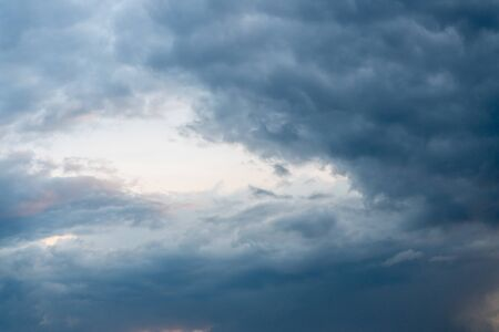 Clouds before the storm in the blue sky. Banco de Imagens