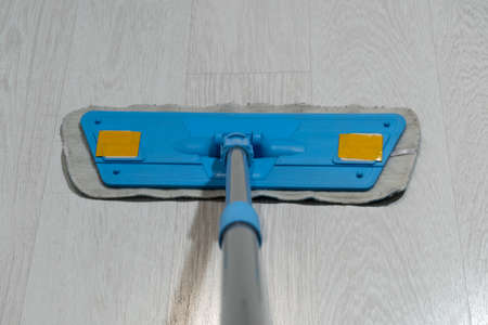 Close-up of a mop wiping the floor. Banco de Imagens