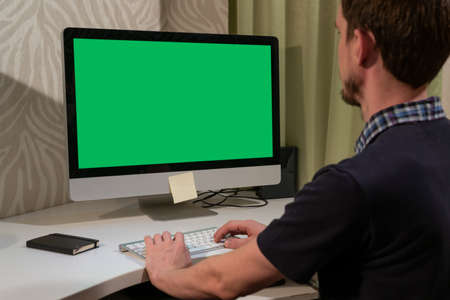 Man with Green screen PC