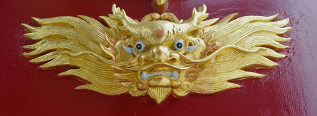 godliness: gold dragon chinese statue style on red wall background
