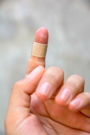 brown medicine bandage on injured finger Imagens