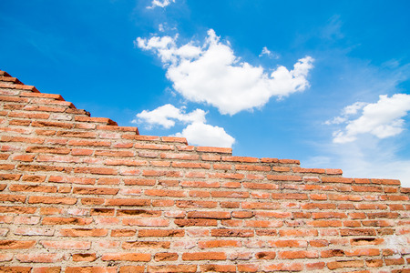 foundation cracks: Brick wall with sky  Stock Photo