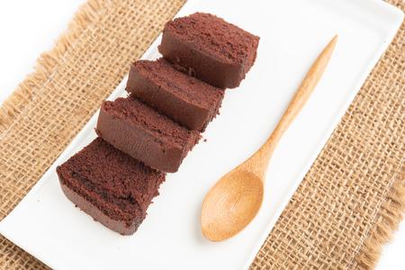 sliced bar cake chocolate slice slices in white background. 스톡 콘텐츠 - 103690486