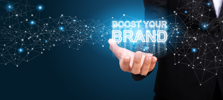 Boost Your Brand in the hand of business. Boost Your Brand concept. Фото со стока
