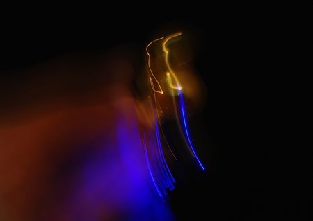 Blue and yellow shone beams on a dark background.
