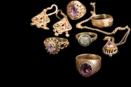 coulomb: The Golden jewellerys, is isolated on a black background