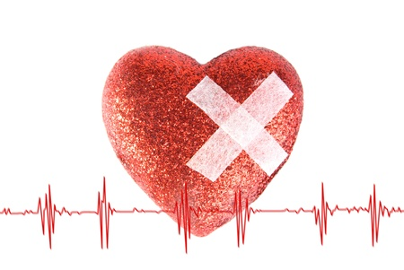 The heart is stuck with a plaster, and cardiogramme photo