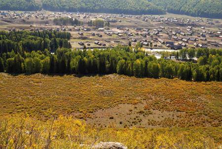 Xinjiang, China, autumn grasses and town Stock Photo - 12855973