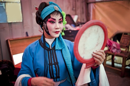 CHENGDU, CHINA-MARCH 12, 2011: Unidentified actor prepares backstage for the Sichuan opera on March 12, 2011, in Chengdu, China.  Sichuan opera is a Chinese folk tradition that originated in China around 1700. Stock Photo - 12734534