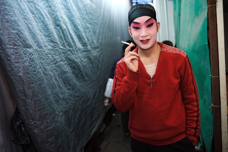 CHENGDU, CHINA-DECEMBER 11, 2011: Unidentified actor prepares backstage for the Sichuan opera on DECEMBER 11, 2011, in Chengdu, China.  Sichuan opera is a Chinese folk tradition that originated in China around 1700. Stock Photo - 12734578