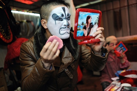 CHENGDU, CHINA-DECEMBER 11, 2011: Unidentified actor prepares backstage for the Sichuan opera on DECEMBER 11, 2011, in Chengdu, China.  Sichuan opera is a Chinese folk tradition that originated in China around 1700.
