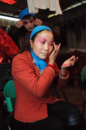 CHENGDU, CHINA-DECEMBER 11, 2011: Unidentified actor prepares backstage for the Sichuan opera on DECEMBER 11, 2011, in Chengdu, China.  Sichuan opera is a Chinese folk tradition that originated in China around 1700. Stock Photo - 12734573