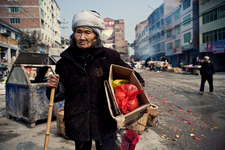 anonymity: Sichuan Province, China 2 February: Sichuan rural areas, Chinese New Year, a poverty of anonymity old woman, picking up trash on the streets, Sichuan, China, February 2, 2011