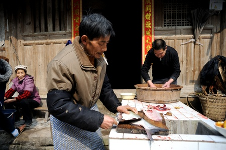 sichuan province: Sichuan, China - February 2: Chinas rural household food preparation, February 2, 2011, in rural areas in Sichuan Province during the Spring Festival, a person is preparing food for the holidays Editorial