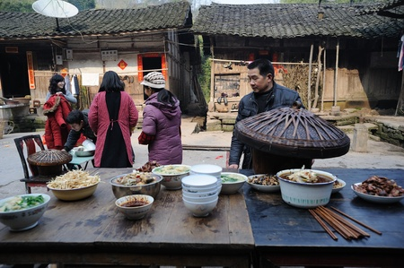 Sichuan Province, China 2 February: Sichuan rural areas, Chinese New Year, a woman who declined to be named, is preparing food for the family, reunion dinner, Sichuan, China, February 2, 2011 Stock Photo - 12768792