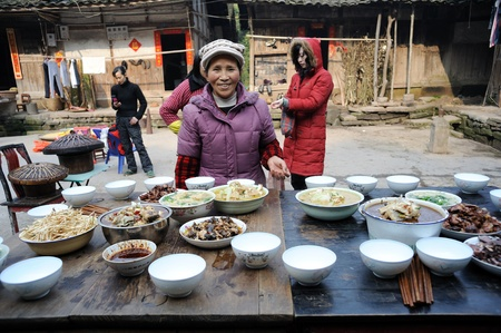 Sichuan Province, China 2 February: Sichuan rural areas, Chinese New Year, a woman who declined to be named, is preparing food for the family, reunion dinner, Sichuan, China, February 2, 2011 Stock Photo - 12768785
