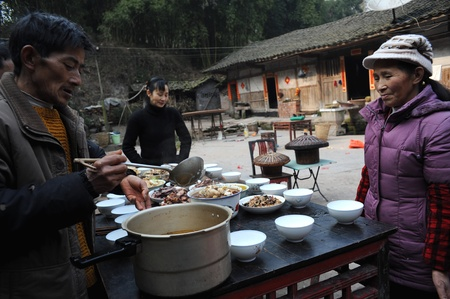 Sichuan Province, China 2 February: Sichuan rural areas, Chinese New Year, a woman who declined to be named, is preparing food for the family, reunion dinner, Sichuan, China, February 2, 2011 Stock Photo - 12768761