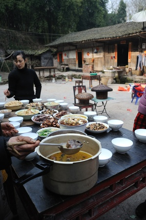 Sichuan Province, China 2 February: Sichuan rural areas, Chinese New Year, a woman who declined to be named, is preparing food for the family, reunion dinner, Sichuan, China, February 2, 2011 Stock Photo - 12768764