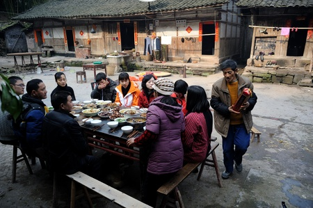 Sichuan Province, China 2 February: Sichuan rural areas, Chinese New Year, people are eating a family dinner, this is the most important Chinese festivals, Sichuan, China, February 2, 2011