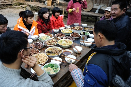 sichuan province: Sichuan Province, China 2 February: Sichuan rural areas, Chinese New Year, people are eating a family dinner, this is the most important Chinese festivals, Sichuan, China, February 2, 2011 Editorial