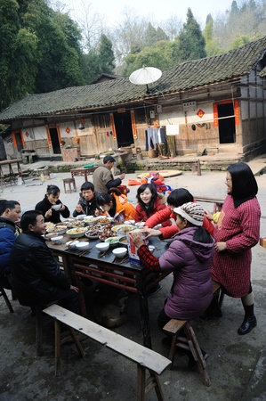 Sichuan Province, China 2 February: Sichuan rural areas, Chinese New Year, people are eating a family dinner, this is the most important Chinese festivals, Sichuan, China, February 2, 2011 Editorial