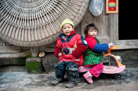 DAzhu,Sichuan Province ,China-February ,2TH,2011:Two Chinese children at play in rural